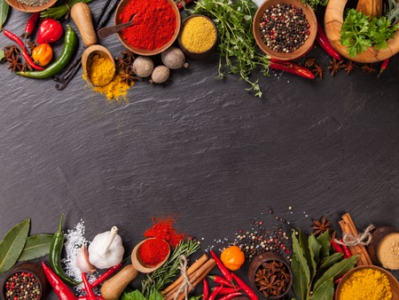 Photo for Various spices on black stone shot from aerial view - Royalty Free Image