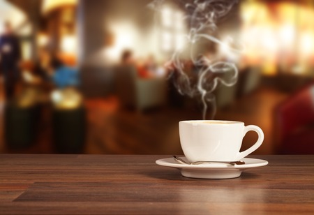 Foto de Coffee drink on wooden table with blur cafeteria  - Imagen libre de derechos