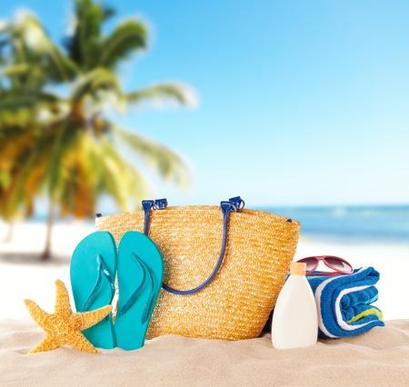 Foto de Summer beach with accessories. Blur azure sea on background - Imagen libre de derechos