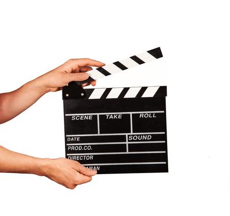 Foto de Man hands holding film clapper isolated on white background - Imagen libre de derechos