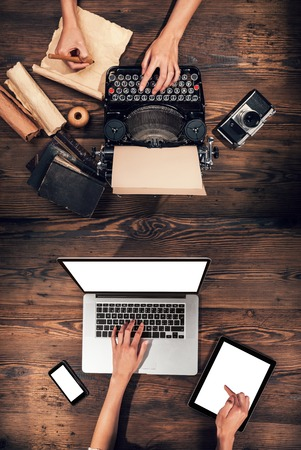 Photo pour Old typewriter with laptop, concept of technology progress - image libre de droit