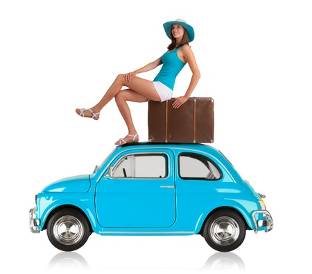 Photo pour Beautiful young woman posing on old car, manufactured between year 1957 - 1975. Concept of summer travel. Isolated on white background - image libre de droit