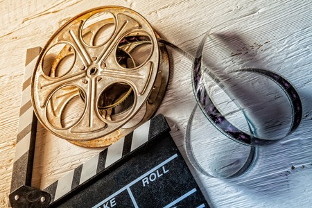 Photo for Film camera chalkboard and roll on wooden table - Royalty Free Image