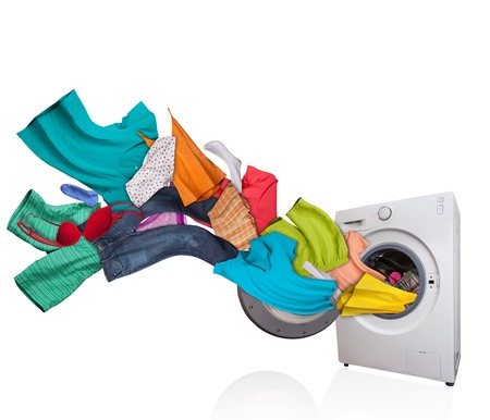 Photo pour Colored laundry flying from washing machine, isolated on white background - image libre de droit