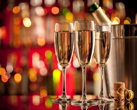 Photo for Glasses of champagne in holiday setting, served on bar counter - Royalty Free Image