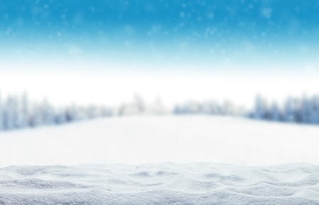 Foto de Winter background with pile of snow and blur landscape. Copyspace for text - Imagen libre de derechos