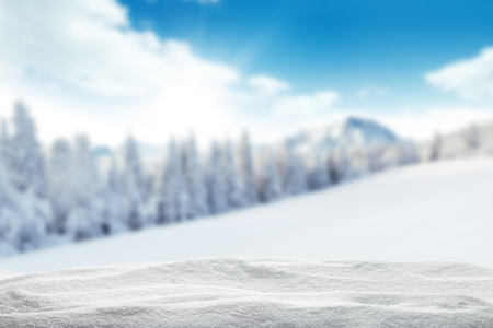 Photo pour Winter background with pile of snow and blur landscape. Copyspace for text - image libre de droit