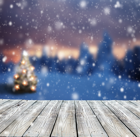 Photo for Winter background with mole and blur evening landscape. Empty wooden planks on foreground. Copyspace for text - Royalty Free Image