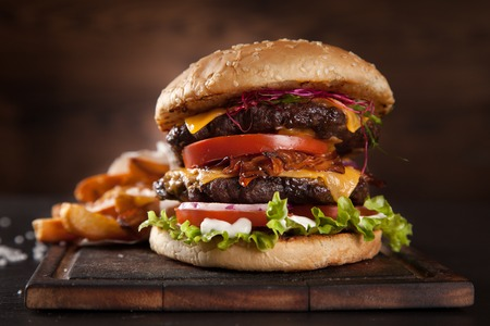 Photo for Delicious hamburger served on wooden planks - Royalty Free Image