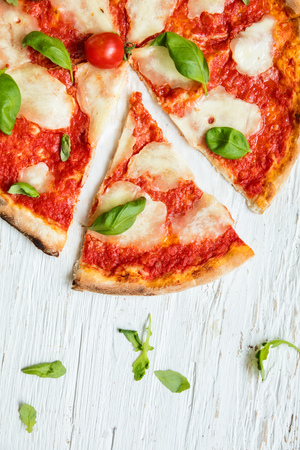 Photo pour Delicious italian pizza served on wooden table, shot from above - image libre de droit