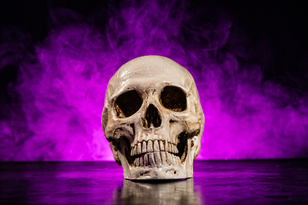 Photo pour Old human skull head with smoke on dark background - image libre de droit