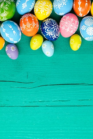 Photo for Colorful easter eggs placed on wooden background - Royalty Free Image