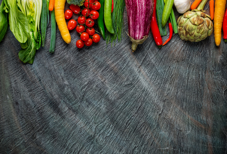 Photo for Collection of fresh vegetables placed on black stone with free space for text - Royalty Free Image