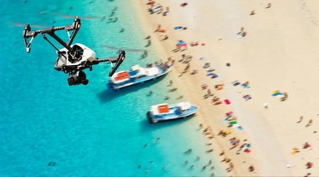 Foto de Drone for industrial works flying above beach. Concept of pottential danger of aircraft collision - Imagen libre de derechos