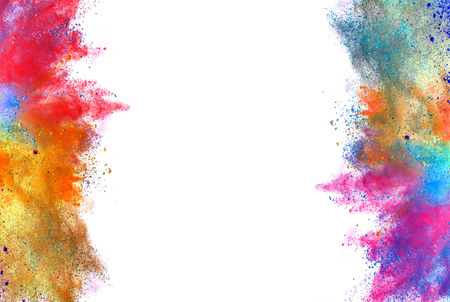 Foto de Explosion of colored powder, isolated on white background - Imagen libre de derechos