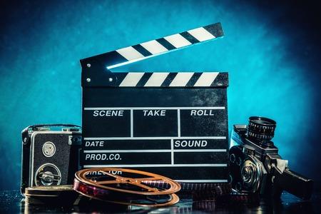 Foto de Retro film production accessories still life. Concept of filmmaking. Smoke effect on background - Imagen libre de derechos