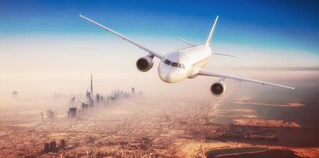 Photo pour Commercial airplane flying over modern city with skyscrapers - image libre de droit