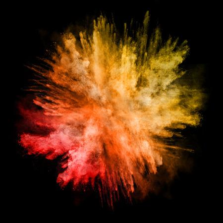 Foto de Explosion of colored powder, isolated on black background - Imagen libre de derechos