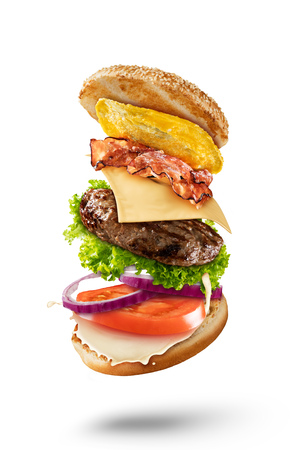 Photo for Maxi hamburger with flying ingredients isolated on white background. High resolution image - Royalty Free Image
