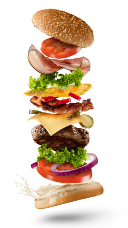 Photo pour Maxi hamburger with flying ingredients isolated on white background. High resolution image - image libre de droit