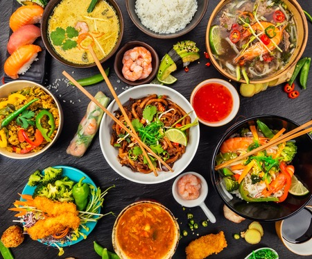Photo for Asian food served on black stone, top view. Chinese and vietnamese cuisine set. - Royalty Free Image