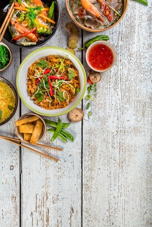 Photo for Asian food served on white wooden table, top view, space for text. Chinese and vietnamese cuisine set. - Royalty Free Image