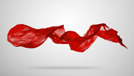 Foto de Smooth elegant red transparent cloth separated on grey background. Texture of flying fabric. - Imagen libre de derechos