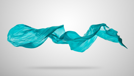 Photo for Smooth elegant blue transparent cloth separated on grey background. Texture of flying fabric. - Royalty Free Image