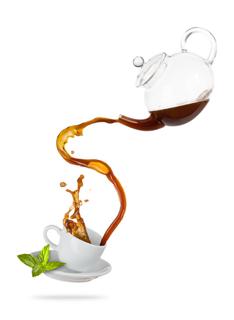Foto de Porcelaine white cup with splashing tea from jug, separated on white background. Hot drink with splash, beverages and refreshment. Very high resolution image - Imagen libre de derechos