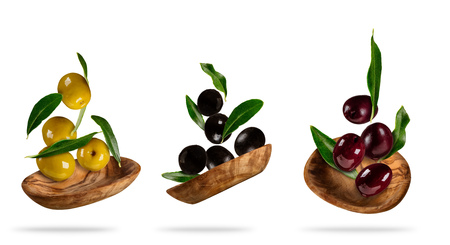 Photo for Collection of various kind of flying olives in wooden bowls, isolated on white background - Royalty Free Image