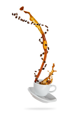 Photo for Splashing coffee drink from the cup with flying beans, isolated on white background - Royalty Free Image