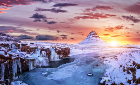 Foto de Kirkjufell mountain with frozen water falls in winter, Iceland. One of the famous natural heritage in Iceland. - Imagen libre de derechos