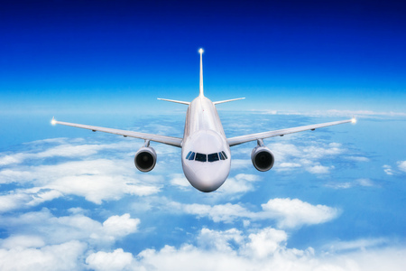 Foto per Commercial airplane jetliner flying above clouds in day light. Concept of travel and business. - Immagine Royalty Free