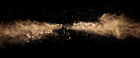 Photo for Abstract colored brown powder explosion isolated on black background. High resolution texture - Royalty Free Image