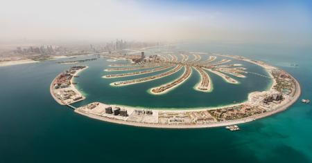 Foto de Aerial view of artificial palm island in Dubai. Panoramic view. - Imagen libre de derechos
