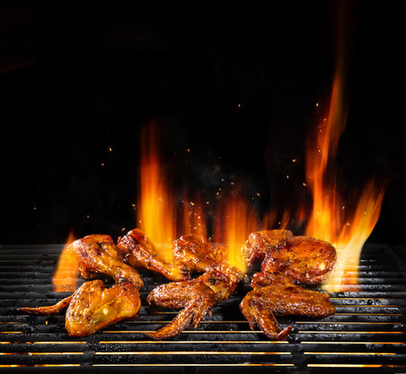 Photo for Delicious pieces of chicken meat on grill with Fire flames. Isolated on black background. Barbecue and grilling. Very high resolution image - Royalty Free Image