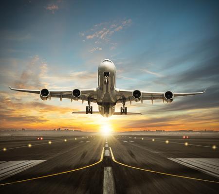 Foto de Huge two storeys commercial jetliner taking of runway. Modern and fastest mode of transportation. Dramatic sunset sky on background - Imagen libre de derechos