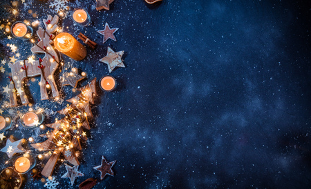 Foto per Christmas background with wooden decorations and candles. Free space for text. Celebration and decorative design. - Immagine Royalty Free