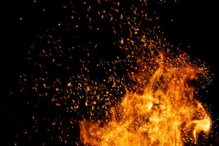 Photo pour Fire sparks particles with flames isolated on black background. - image libre de droit