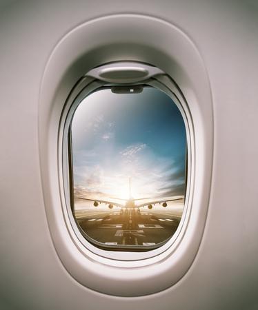 Foto de Airplane window view to runway with huge airplane. Concept of modern and fast travel - Imagen libre de derechos