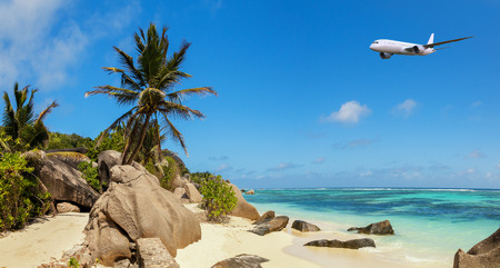 Photo for Beautiful panoramic view of beach in Seychelles with commercial airplane, island La Digue, Anse Source d'Argent. - Royalty Free Image