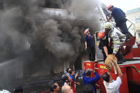 firefighter recuing dog at fire accident in shopping centre