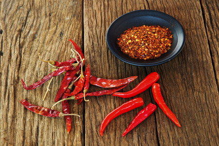 Photo for Cayenne pepper and Red peppers on old wooden table - Royalty Free Image