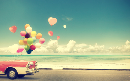 Photo for Vintage Car with heart balloon on beach blue sky concept of love in summer and wedding honeymoon - Royalty Free Image