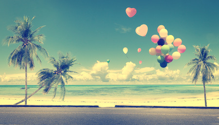 Photo for Vintage with heart balloon on beach blue sky concept of love in summer and wedding honeymoon - Royalty Free Image