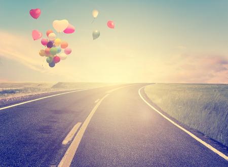 Foto de vintage with heart balloon on beach blue sky concept of love in summer and wedding - Imagen libre de derechos