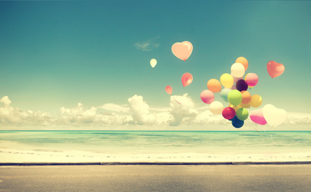 Foto de Vintage  with heart balloon on beach blue sky concept of love in summer and wedding honeymoon - Imagen libre de derechos