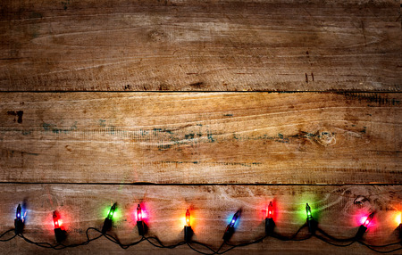Photo pour Christmas rustic background - vintage planked wood with colorful lights and free text space - image libre de droit
