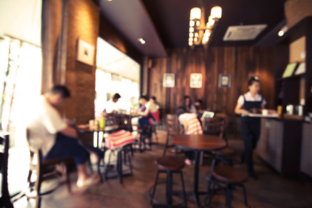 Foto de Coffee shop - cafe blurred background with bokeh image - Imagen libre de derechos