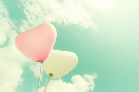 Foto de vintage heart balloon on blue sky concept of love in summer and valentine, wedding honeymoon - Imagen libre de derechos